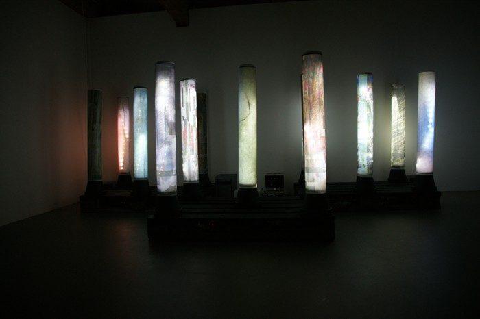 The Flow of Time, das Murmeln der Farben, 2012 (Version Haus für Kunst Uri). 13 x pigm. Inkprint auf Droppapier, Format: 88 x 43 cm zu Röhren geformt