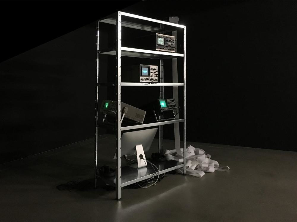 OscillDraw_NotRecognized (angel/dragon/flying_saucer/mermaid), 2017, variable size, oscilloscopes, thermal printer, computer with custom software, shelf